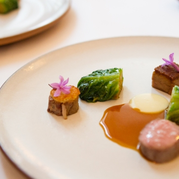 Spring lamb loin, belly, and shank; braised gem lettuce, lamb jus.