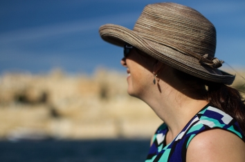 relaxed woman in a hat